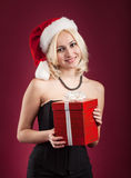 Girl with red gift box Stock Photos