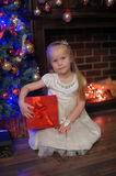 Girl with red gift box at Christmas Stock Photo