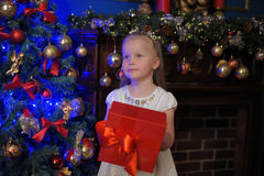 Girl with red gift box at Christmas Royalty Free Stock Photo
