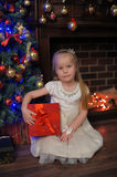 Girl with red gift box at Christmas Stock Image