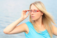 Girl in the red glasses Royalty Free Stock Photos
