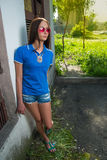 Girl in red glasses and blue shirt Royalty Free Stock Photos