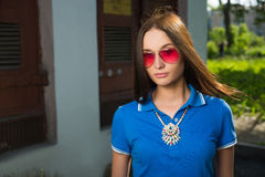 Girl in red glasses and blue shirt Stock Photography