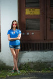 Girl in red glasses and blue shirt Royalty Free Stock Photography