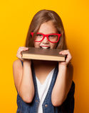 Girl in red glasses with books Royalty Free Stock Photo