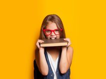 Girl in red glasses with books Royalty Free Stock Photos