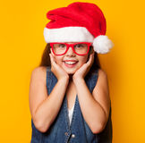 Girl in red glasses and Santas Royalty Free Stock Image