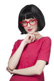 Girl in red glasses at white background. Royalty Free Stock Photo
