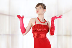 Girl in red gloves raised their hands. Stock Photos