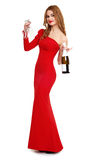 Girl in red gown with champagne and wineglass on white Stock Photos