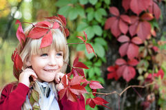Girl with red grape leaves on head. Girl with red grape leaves on her head Stock Image