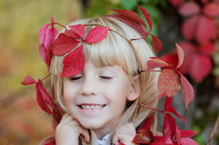 Girl with red grape leaves on head. Girl with red grape leaves on her head Royalty Free Stock Images