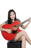 Girl with red guitar. Picture of a girl with red guitar Royalty Free Stock Photos