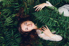 Girl with red hair in an armful of ferns. Women with red hair in an armful of ferns Stock Images