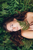 Girl with red hair in an armful of ferns. Women with red hair in an armful of ferns Royalty Free Stock Images