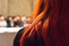 Girl with red hair below shoulders stock photos
