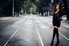 Girl with red hair. Cute girl with red hair on city road stock photos