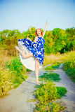 The girl with red hair is dancing Royalty Free Stock Images