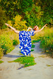 The girl with red hair is dancing Stock Photography