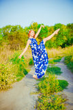 The girl with red hair is dancing Royalty Free Stock Photography