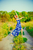 The girl with red hair is dancing Stock Image