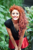 Girl with red hair dressed as mother Christmas Royalty Free Stock Photo