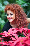 Girl with red hair dressed as mother Christmas Stock Images