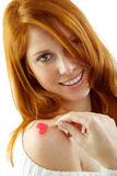 Girl with red hair holding a heart Royalty Free Stock Photos