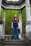 Girl with red hair looking into the distance Stock Images