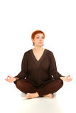 The girl with red hair meditates Stock Image