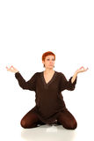 The girl with red hair meditates Royalty Free Stock Images