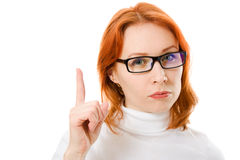Girl with red hair points a finger upward Royalty Free Stock Photos