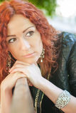 Girl with red hair. Portrait of a girl with red hair royalty free stock images
