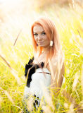 Girl with red hair posing in wheat field Stock Image