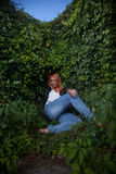 Girl with red hair sitting near ivy Royalty Free Stock Photo