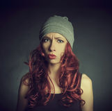 The girl with red hair in a sports cap Royalty Free Stock Images