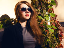 Girl with red hair and sunglasses Royalty Free Stock Images