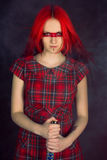 Girl with red hair and a sword Royalty Free Stock Photo