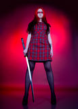 Girl with red hair and a sword Stock Images