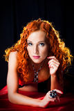 Girl with red hair wearing amber jewellery Royalty Free Stock Images