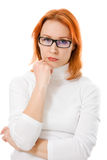 Girl with red hair wearing glasses thinking Royalty Free Stock Images