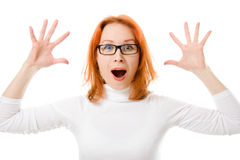 Girl with red hair wearing glasses was surprised Stock Images