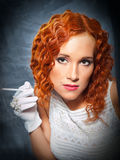 Girl with red hair wearing white dress and gloves Royalty Free Stock Photos