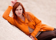 Beautiful, attractive, sexual, seductive, red-haired girl with red sweater, hair.  Stock Photography