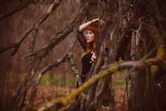 Girl red-haired model woman in black dress dry Stock Photos