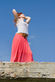 Girl, red-haired standing on the bridge Stock Image