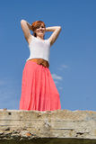 Girl, red-haired standing on the bridge Royalty Free Stock Image
