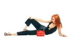 Girl with red handbag Stock Image