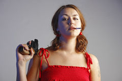 Girl in red has got a gun Royalty Free Stock Image