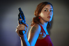 Girl in red has got a gun Stock Image